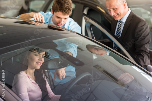 Caucasian couple choosing car
