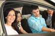 Family sitting in car in retail store