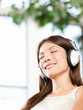 Woman enjoying music in headphones at home relaxed