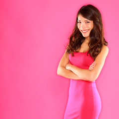 Smiling playful confident beautiful woman in pink