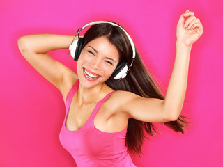Music - woman wearing headphones dancing