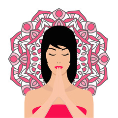 Girl practicing meditation,with mandala on the background