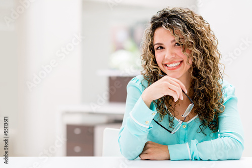 Happy woman at the office