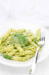 pasta penne with sauce of arugula and peas vertical