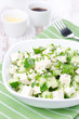 salad with cucumber, tofu, chives and sesame seeds, vertical