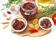 sun dried tomatoes, pasta and spices on wooden board, isolated