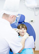 little girl during inspection of oral cavity