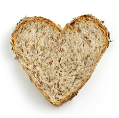 heart shaped slice of brown bread