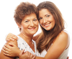 happy mature mother ang adult daughter