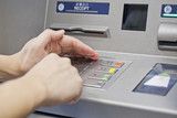 Hand using atm machine
