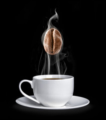 Cup of coffee with a hot coffee bean in a steam