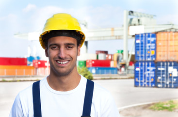 Laughing worker on a seaport