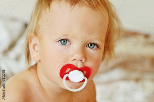 toddler with dummy