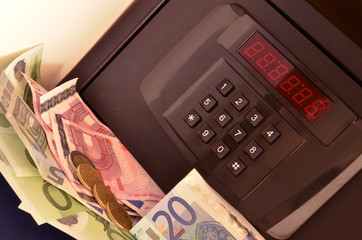 Safe with electronic locker, euro banknotes and coins