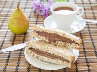 toast bread with creamy chocolate and tea, delicious breakfast