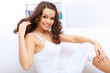 Young pretty woman in white at home