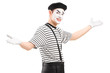 Male mime dancer gesturing with hands