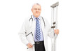 Medical doctor holding crutches