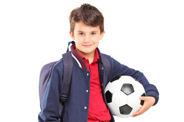 Schoolboy holding a soccer ball