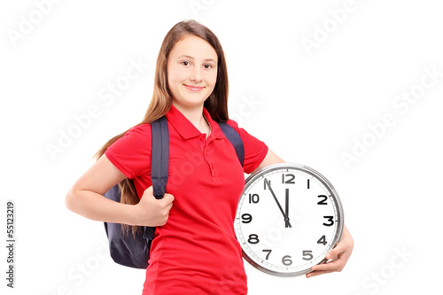 Female student holding a wall clock