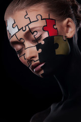 puzzles painted on face