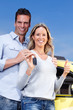 Couple with a car key.