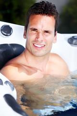 Happy man in hot tub