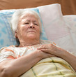 Senior woman lying at bed