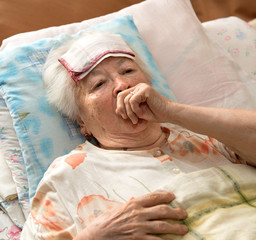 Senior woman lying at bed