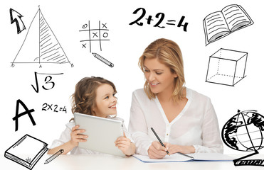 girl and mother doing homework with tablet pc