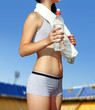 woman's body with bottle of water