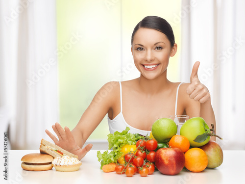 woman with fruits rejecting junk food