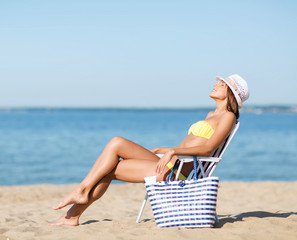 girl sunbathing on the beach chair