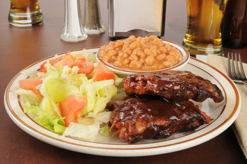 Baby back ribs and salad