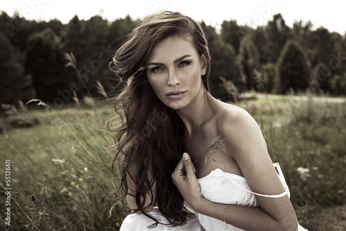 Vogue style portrait of young woman on meadow - 55126611