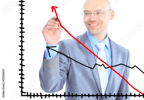 Businessman draws a graph.
