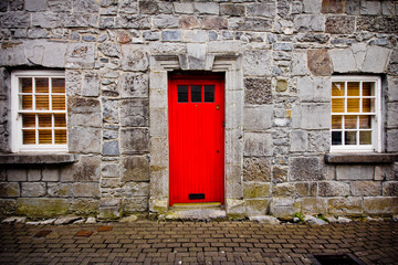 Red door on old European stone house