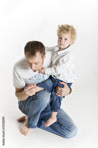 Father is consoling his hurting son