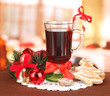Hot tasty drink with christmas candy and other decorations