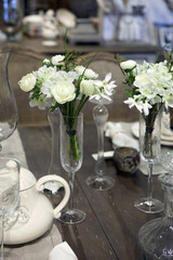 dining table was decorated with artificial  flower