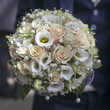 beauty wedding bouquet of roses in groom hands.