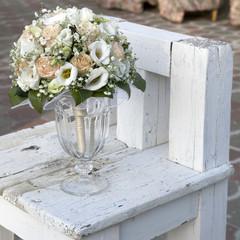 Wedding bouquet of yellow cream roses in  vase