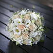Wedding bouquet of yellow cream roses lying