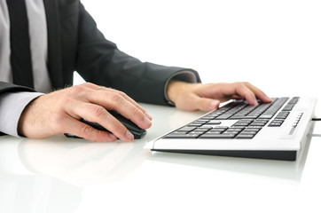 Side view of business man using computer