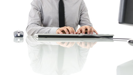 Front view of businessman working on computer