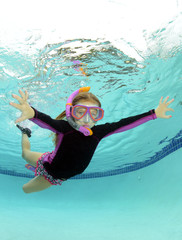 cute kid underwater in pool