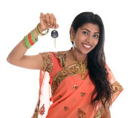 Indian woman holding car key