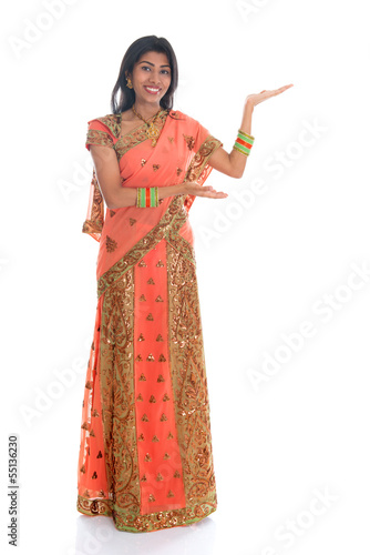 Indian woman showing empty space