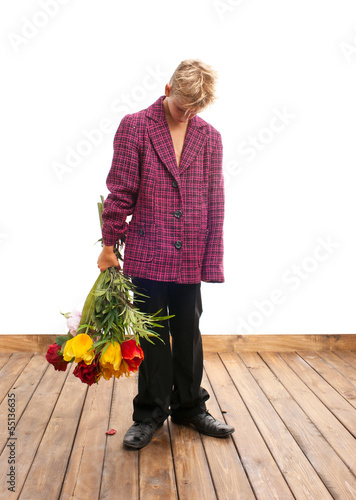 Sad teenager with bouquet