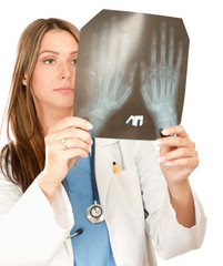 Female doctor with an x-ray isolated on white background.